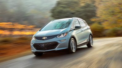 2018-Chevrolet-Bolt-EV-on-road-front-side-highway-trees-background-blur-widescreen-hd-wallpaper